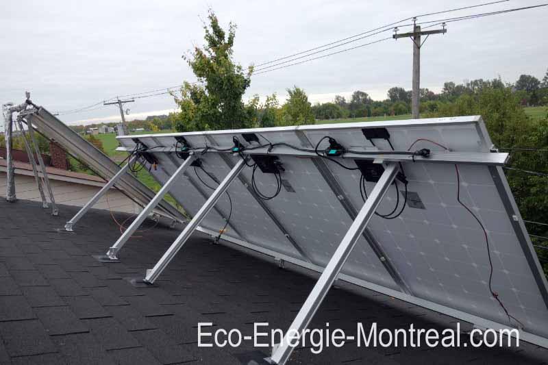 Panneaux solaires photovoltaiques PV SolarWorld 265W monocristallins et chauffe-eau solaire sur ma maison de Montréal,.au Québec